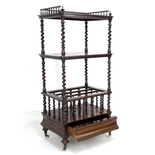 261 - A Victorian rosewood whatnot with Canterbury base, of three tiers, three quarter gallery with turned...