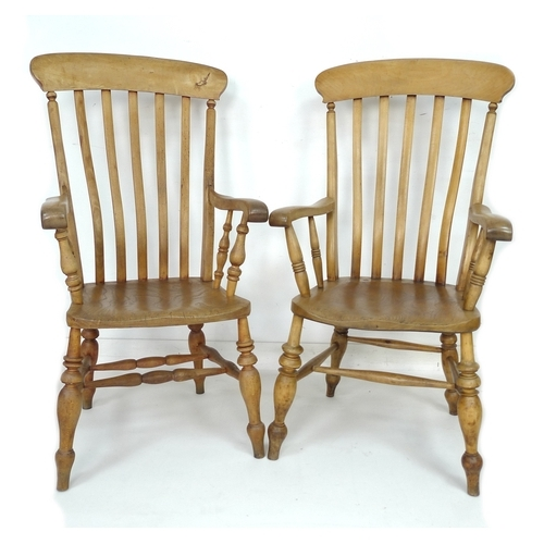 232 - A pair of early 20th century slat back elbow kitchen chairs, 56 by 62 by 114cm high, and 61 by 65 by...