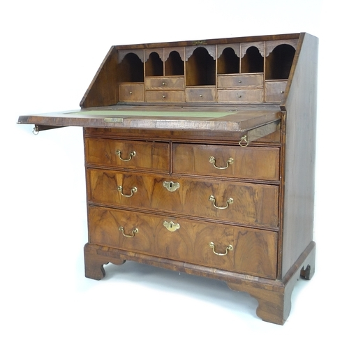 301 - A late 17th century walnut oyster veneered bureau, herringbone crossbanded, fall front with fitted i...