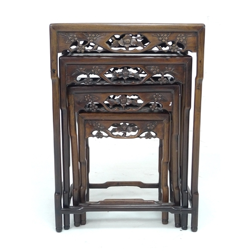 269 - A nest of four Chinese hardwood tables, late 19th or early 20th century, possibly huanghuali, the re...