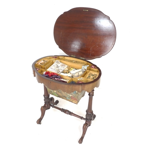 256 - A Victorian mahogany work box and contents, shaped oval surface with moulded edges, fitted interior ...