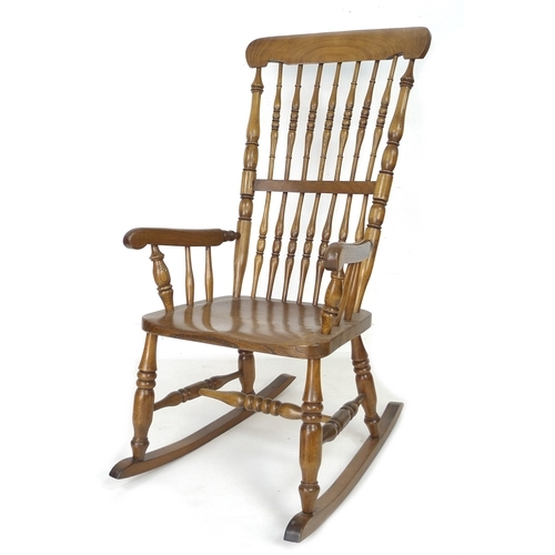 262 - A Victorian elm stick back rocking chair, with turned H stretcher, 56 by 70 by 107cm high....