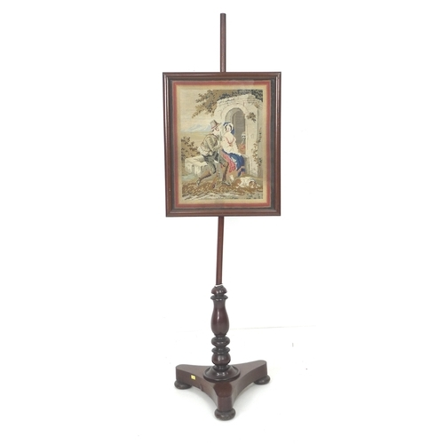 249 - A Victorian mahogany pole screen, with rectangular panel set with embroidery of a hunter courting a ...