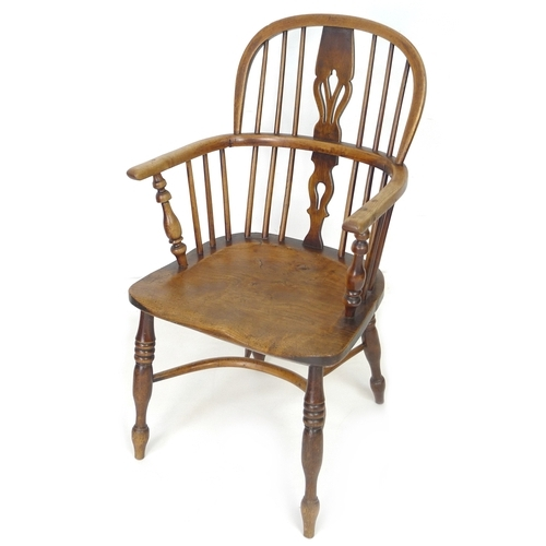 292 - A 19th century oak and elm Windsor chair, low rounded back with pierced splat and stick supports, cr...