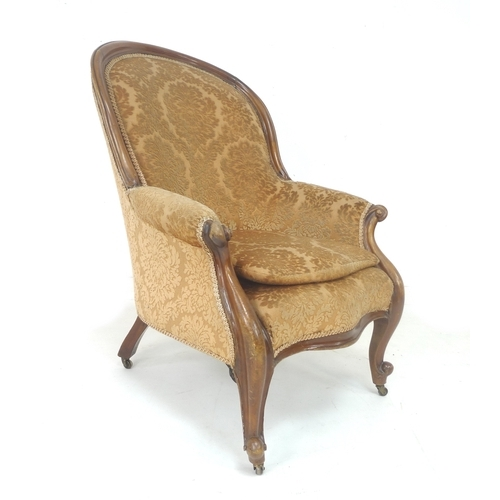 259 - A Victorian mahogany and walnut framed armchair, carved and moulded frame, serpentine front rail, lo...
