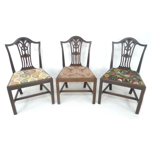 277 - A set of three George III mahogany dining chairs, Hepplewhite period, with moulded frames, pierced, ...