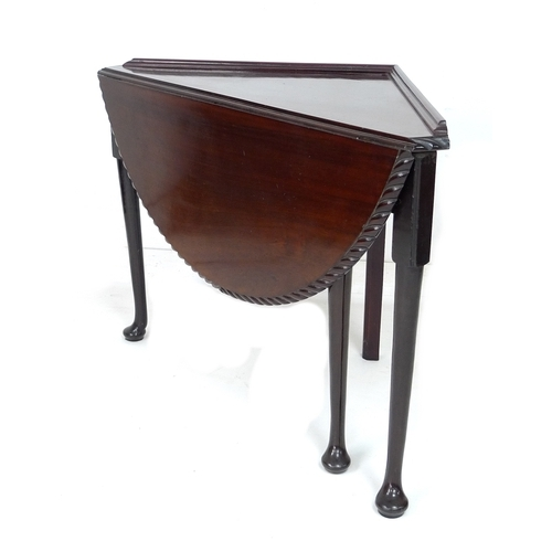 293 - A 19th century mahogany corner drop leaf table, the triangular surface with moulded upstand with sem...