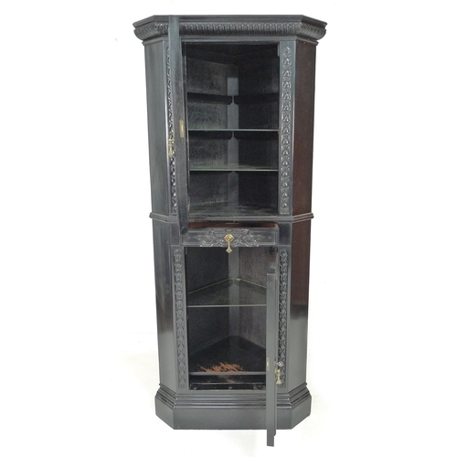 268 - An early 20th century ebonised corner cupboard, in the manner of Collinson & Lock, of freestanding f...