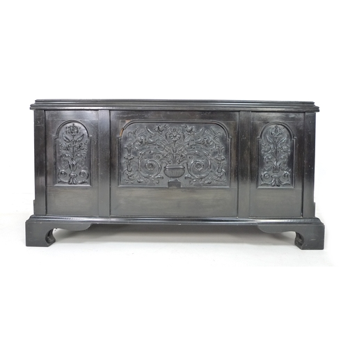 267 - An early 20th century ebonised chest, in the manner of Collinson & Lock, the lid and front panels fi...
