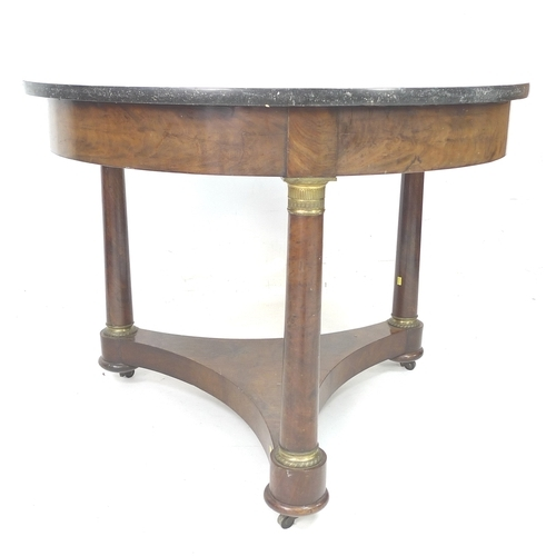 278 - A Regency centre table, mahogany veneered, with circular black marble surface supports on a plain fr...