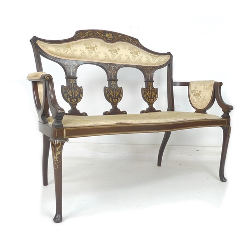 257 - A Victorian mahogany and inlaid salon settee, scrolling foliate and floral inlaid decoration, three ...