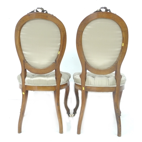 288 - A pair of French 19th century salon chairs, brass mounted with beading, ribbon surmount and floral s...