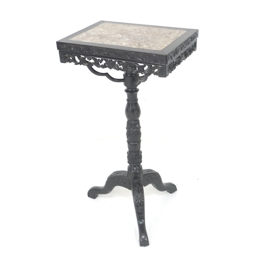 271 - A Chinese 19th century carved and pierced side table, the rectangular surface inset with pink marble...