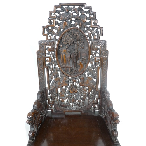 272 - A pair of Chinese hardwood chairs, possibly huanghuali, profusely carved with birds, flowers, figure...