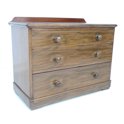 258 - A late Victorian chest of three graduating drawers, with turned wooden handles, 107 by 53 by 83cm hi...