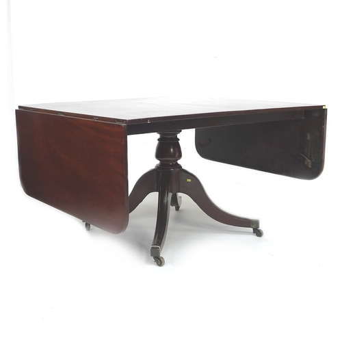 242 - A Regency style mahogany sofa or dining table, mid 20th century, of large proportions, with drop lea...