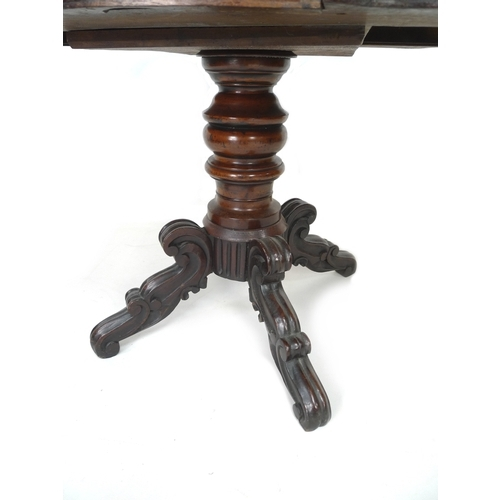 255 - A Victorian mahogany veneered centre table, the shaped surface with moulded edge, two frieze drawers...