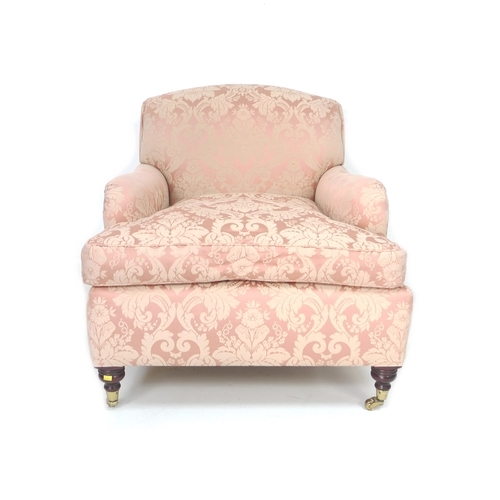 244 - A Victorian style club armchair, in the style of Howard & Sons, upholstered in dusty pink fabric, ra...