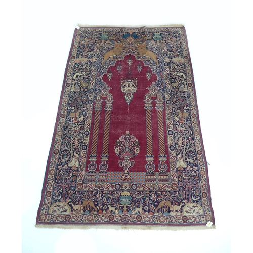 289 - An antique Persian Teheran prayer rug, 'The Entrance to Temple', with wine coloured ground, mihrab a...
