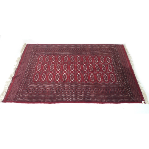 246 - A Tekke rug with red ground, three rows of twelve medallions, 160 by 250cm....