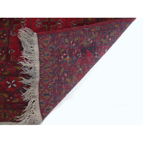 274 - A Persian runner with red ground, 80 by 290cm....