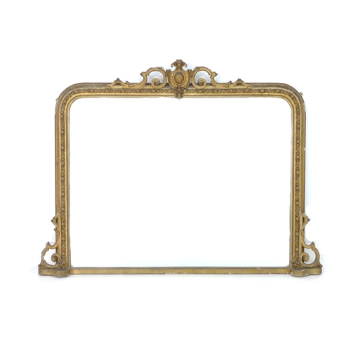 282 - A large rectangular giltwood overmantle mirror, with scroll shield pediment and bead, harebell and r...