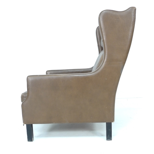 222 - A retro Danish wing armchair in the style of Borge Mogensen, upholstered in brown leather, 68 by 93 ...