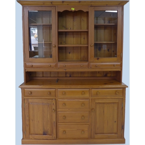 231 - A pitch pine dresser, 20th century, with open shelves flanked by glazed cupboards, the base with six...