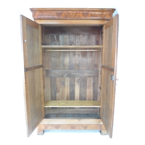 287 - A French 19th century fruitwood armoire, two full length doors enclosing a hanging rail, 140 by 62 b...
