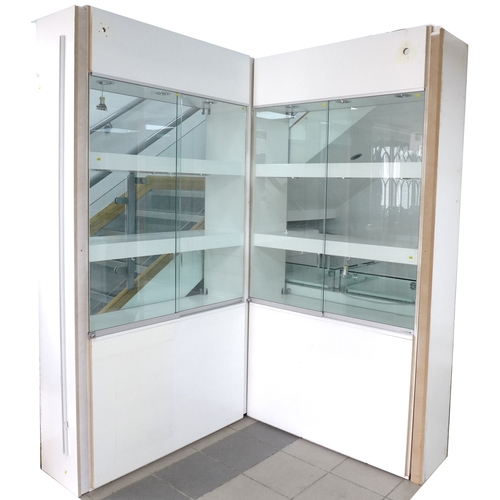 227 - A large modern shop display cabinet, in two sections, white covered MDF and glass panels, with six s...