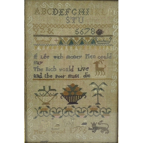 150 - A George III sampler, cross stitch embroidered onto linen, by Mary Wood 1796, 30 by 20cm, glazed and...
