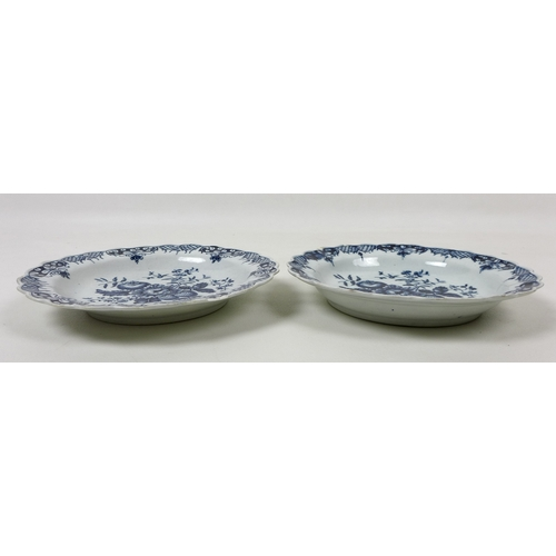 39 - A pair of 18th century Caughley porcelain side plates, decorated with floral sprays and rose hips, w...
