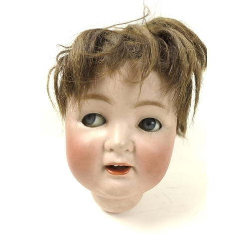 134 - An early 20th century German bisque headed doll, dis-assembled, the eyes currently moving both up an...