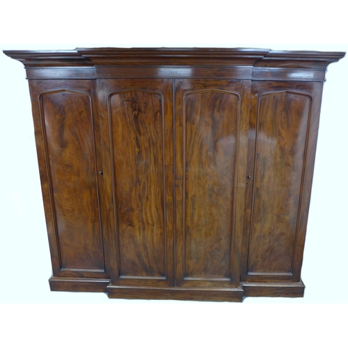 260A - A Victorian mahogany break front wardrobe, four full length doors, the central pair opening to revea...