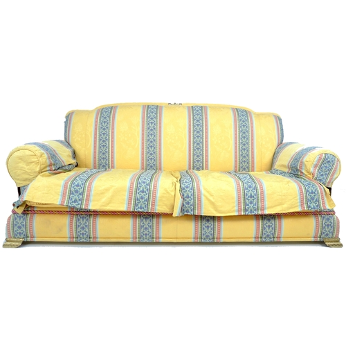 232A - A modern three seater sofa with brass feet, yellow cotton upholstered with striped detailing, 200 by...