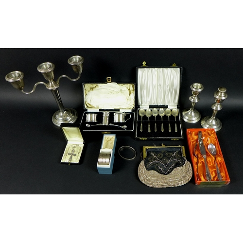 17 - A group of silver items, comprising a pair of candlesticks, Birmingham 1968, W I Broadway & Co, a th...