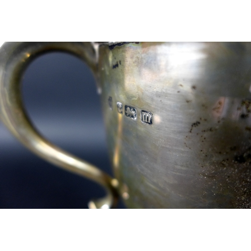 27 - A George V silver twin handled trophy, engraved 'The Coleherne Cup, Two Miles Race for Ponies, prese...