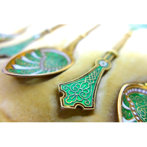 22 - A set of six Art Nouveau Norwegian silver-gilt and green and white enamel teaspoons, marked WFB, lik...