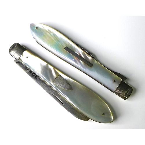 21 - A cased set of folding silver and mother of pearl cutlery, comprising knife and fork....