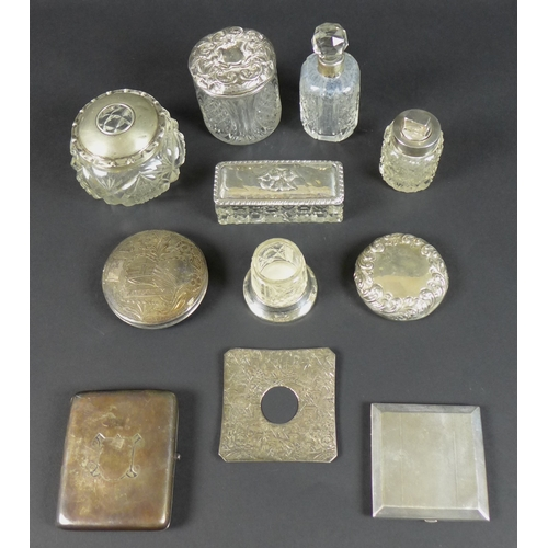 8 - A group of seven silver items, including a silver cigarette case with parcel gilt interior, Deakin &...