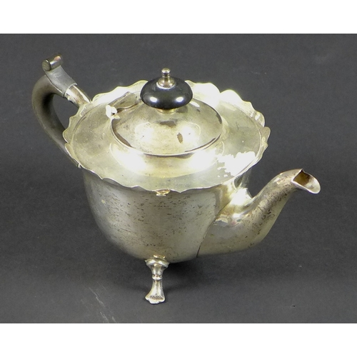 2 - An early 20th century small silver teapot, with ebony handle and finial, Mappin and Webb, Sheffield,...