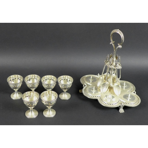 29 - A Victorian silver egg cup stand with six egg cups, raised scroll form handle, all with pierced and ...