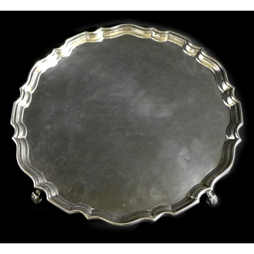 37 - A George V silver salver tray, of circular form with Chippendale pie crust edge, presentation engrav...