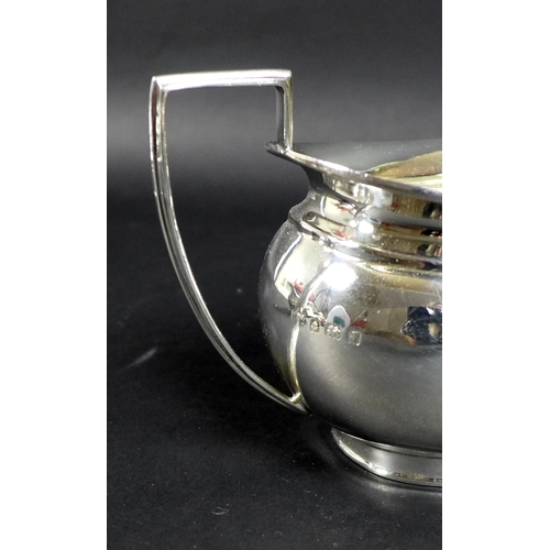 38 - A George V silver three piece tea service, London shape, comprising teapot, twin handled sugar bowl,...