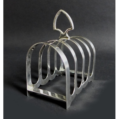 4 - A George VI silver four division toast rack, with shaped carry handle, Viners Ltd, Sheffield 1940, 9...