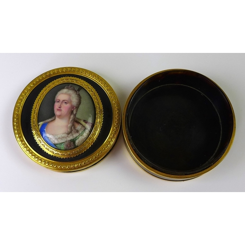 305 - A gold and tortoiseshell snuff box, circa 1765, Louis XVI, of circular form, the lid set with a Berl...