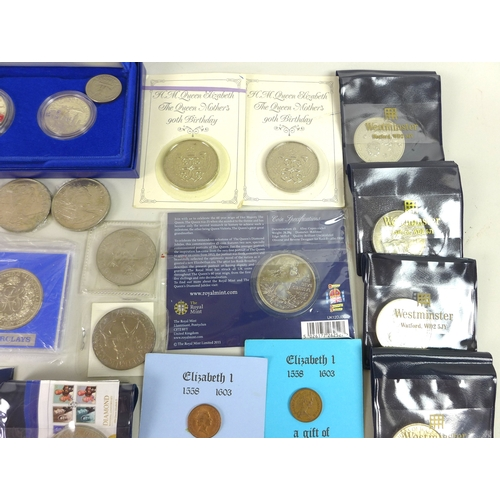 45 - A collection of coins including a silver £1 proof coin, various £5 coins and various silver coins. (...