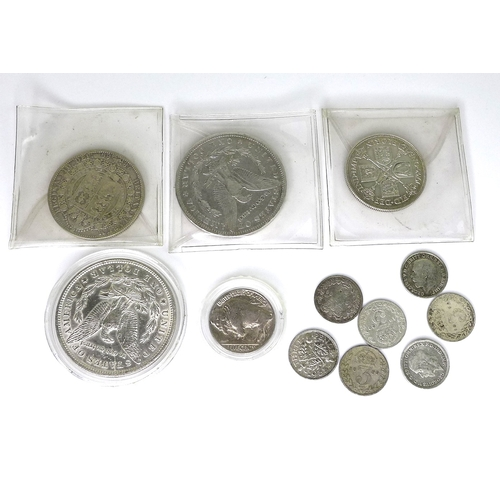 42 - A group of silver coins comprising an 1886 silver Morgan dollar, an 1896 silver Morgan dollar, a 193...