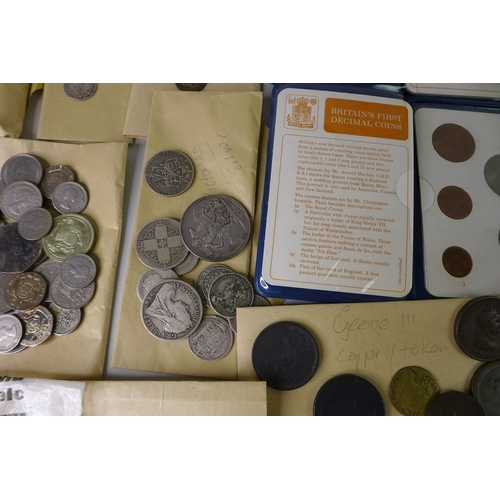 47 - A collection of UK coins, including a £5 coin commemorating the Queen Mother, 2000, three £1 coins, ...
