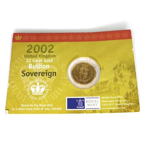 57 - An Elizabeth II gold shield back sovereign, 2002, in original card packaging....